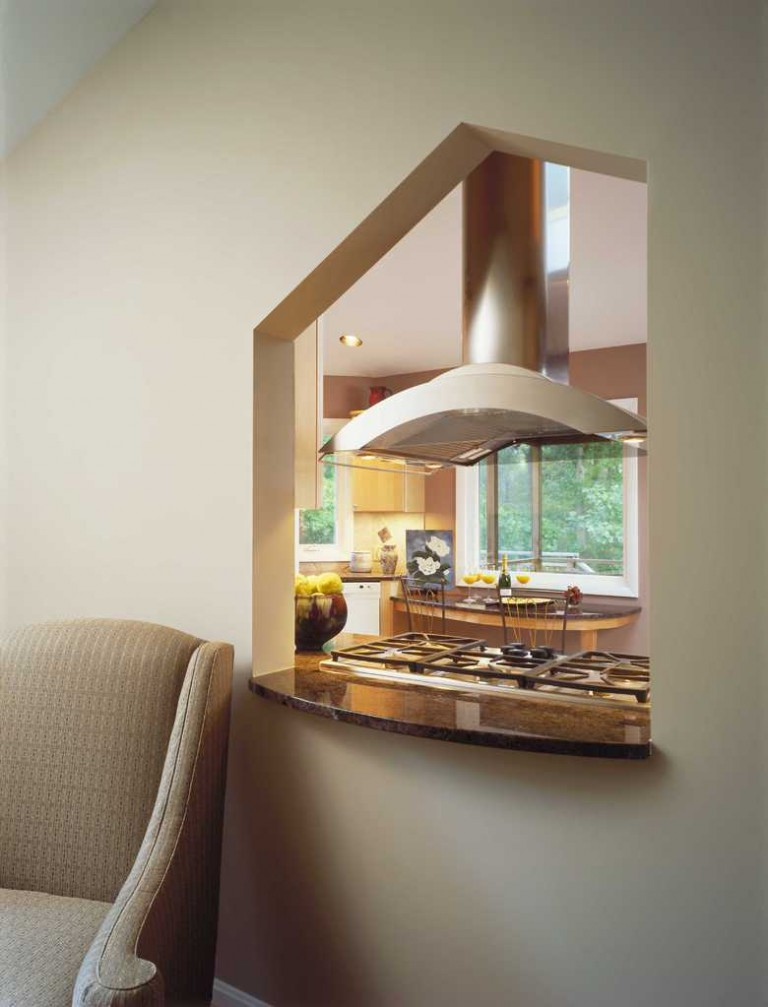 SITTING ROOM INTERIOR WINDOW SHAPED BY TILE DESIGN ON KITCHEN SIDE.