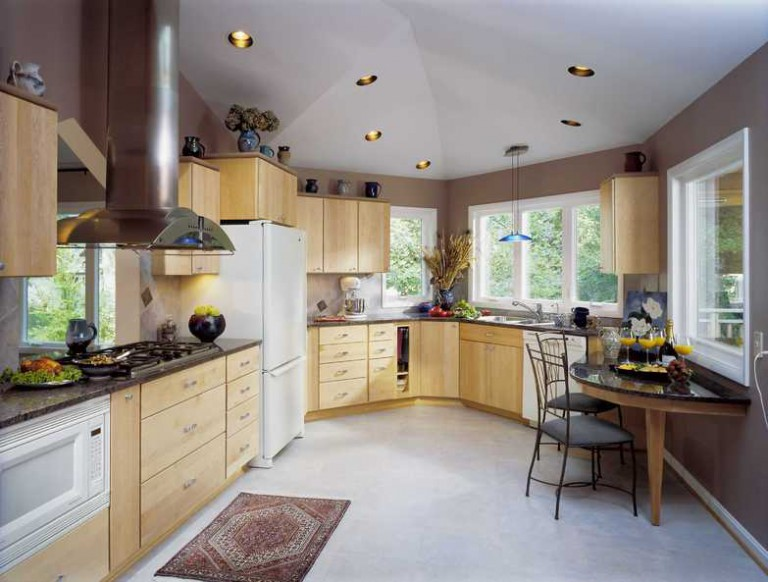 ADDITION ENLARGES KITCHEN, OPENS TO VIEW.