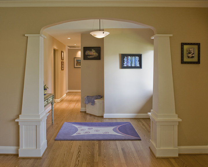NEW ENTRY FRAMED BY CRAFTSMAN STYLED COLUMNS, ARCHED OPENING.