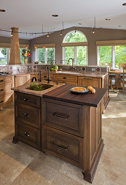 SMALL, SECOND KITCHEN ISLAND FEATURES ACCENT CABINET FINISH.