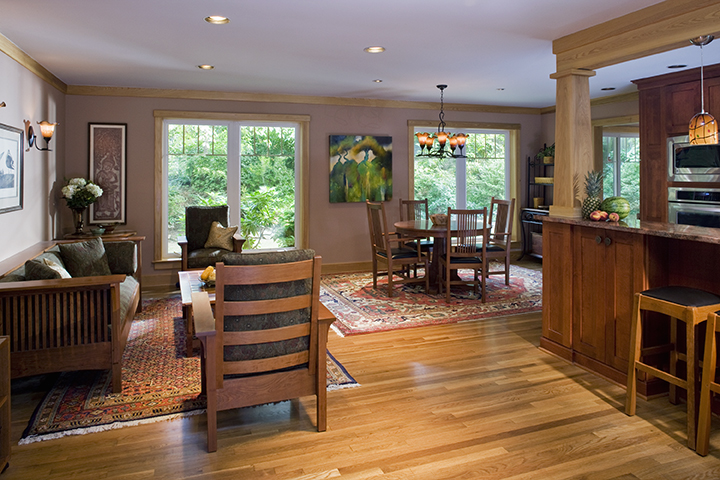 OPEN LIVING ROOM INVITES QUIET SPACE, ALLOWS COMMUNICATION WITH KITCHEN OCCUPANTS, DINING ROOM BEYOND.