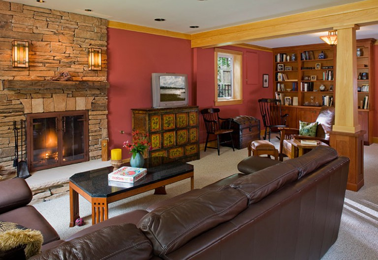 NEW FAMILY ROOM OPEN AND INVITING WITH WALL REMOVED, RESTYLED FIREPLACE. CRAFTSMAN POST CLADS BEARING COLUMN. BOOK SHELVES CREATE DISPLAY, STORAGE, AND QUIET READING CORNER.