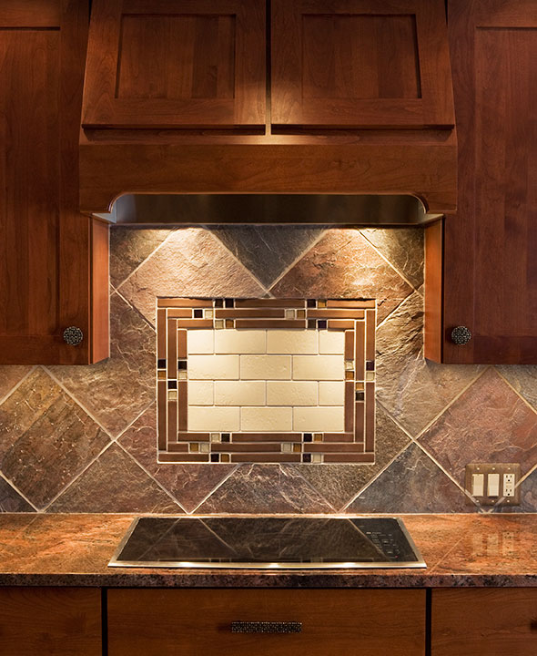 BACKSPLASH TILE ACCENT IN SLATE FIELD FURTHER UNDERSCORES CRAFTSMAN THEME.