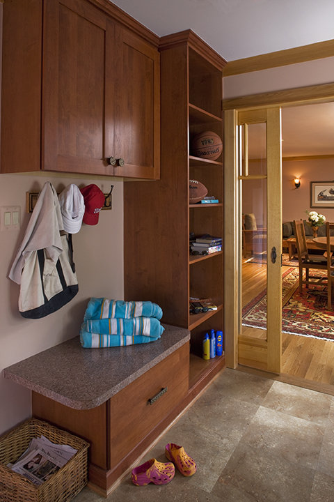 MUDROOM ADDITION PROVIDES INDIVIDUAL DOWNLOAD CUBBIES FOR EACH FAMILY MEMBER.