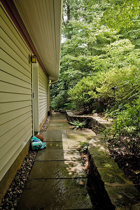 NEW GARAGE REQUIRED WATER MANAGEMENT ON STEEPLY SLOPED SIDE YARD. ACCESS DOORBELL FOR CHILDRENS' TRAFFIC.