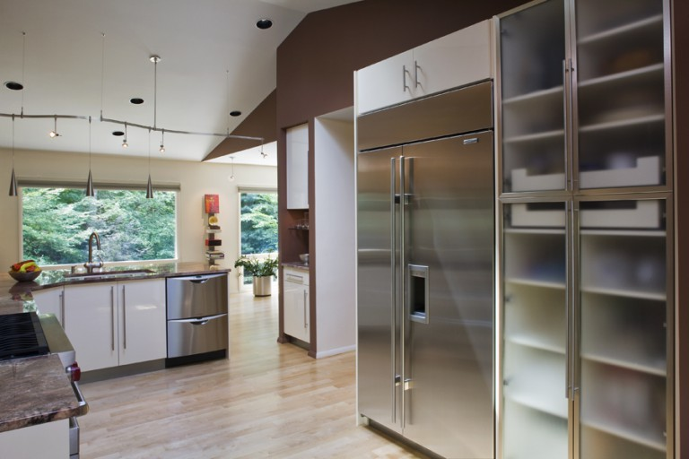 REMOVING THE WALL OPENS TO THE MAGNIFICENT VIEW. STAINLESS STEEL APPLIANCES CONTINUE THE CLEAN LINES.