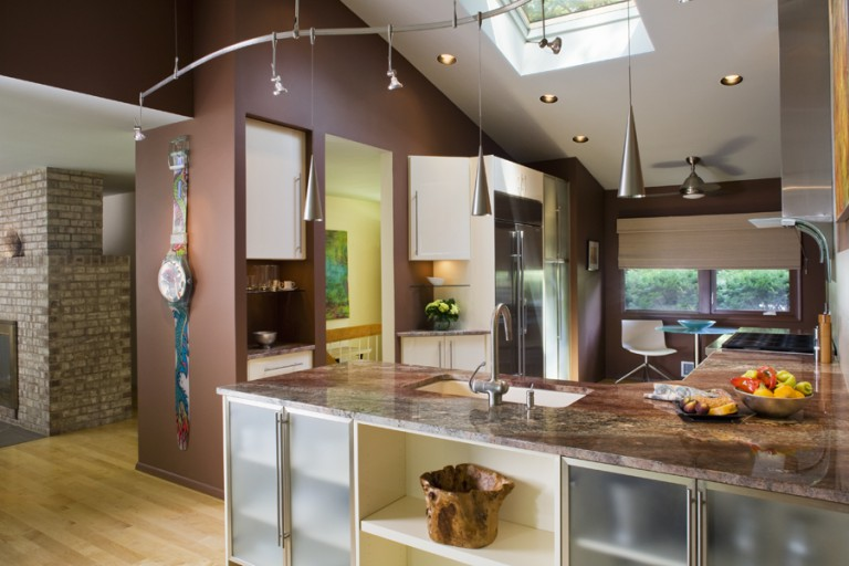 FROSTED GLASS DOORS AND OPEN CABINETS BRING DEPTH AND RHYTHM TO THE CABINET AREAS.