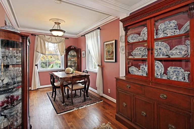 VIEW OF DINING ROOM AND CHINA CABINET